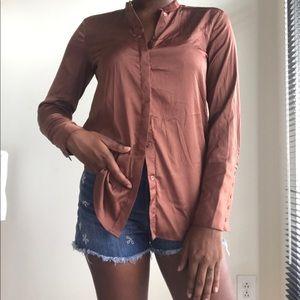 Copper button down shirt.